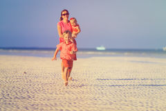Happy little boy with mother and sister running on beach Royalty Free Stock Photos