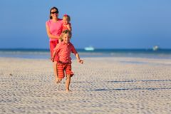 Happy little boy with mother and sister running on Stock Images