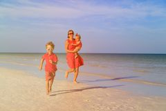 Happy little boy with mother and sister running on Stock Photo