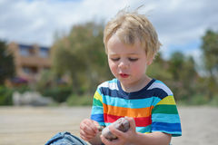 Happy little boy in multicolored t-shirt Stock Images