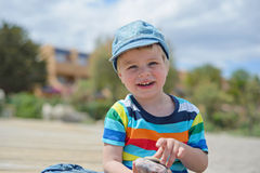 Happy little boy in multicolored t-shirt Royalty Free Stock Photo