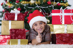 Happy little boy near a Christmas tree Stock Photo