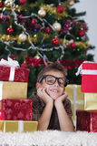 Happy little boy near a Christmas tree Royalty Free Stock Photo