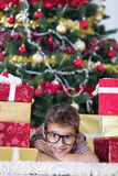 Happy little boy near a Christmas tree Stock Image