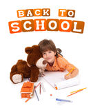 Happy little boy with notebook and teddy bear Royalty Free Stock Images