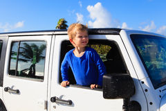 Happy little boy in off road car Royalty Free Stock Photography