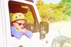 Happy little boy in off road car Stock Photo