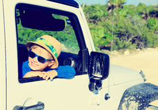 Happy little boy in off road car Royalty Free Stock Photo