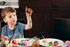 Happy little boy painting Easter eggs, children and creativity royalty free stock photo