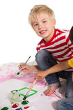 Happy little boy painting on the floor Stock Photos