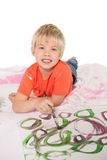 Happy little boy painting on the floor Stock Images