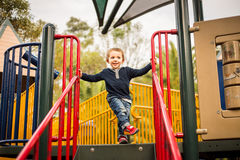 Happy little boy on the playground Stock Image