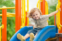 Happy little boy on the playground stock photography
