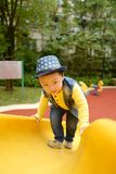 Boy on the playground slide Royalty Free Stock Photos