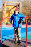 Happy little boy on playground in winter Stock Images