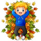 Happy little boy playing with autumn leaves. Illustration of Happy little boy playing with autumn leaves Stock Photos