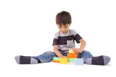 Happy little boy playing with building blocks Royalty Free Stock Images