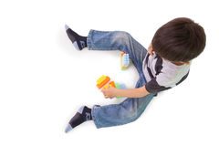Happy little boy playing with building blocks Royalty Free Stock Photos