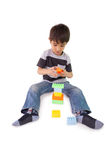 Happy little boy playing with building blocks Stock Image