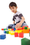 Happy little boy playing with building blocks Royalty Free Stock Photo