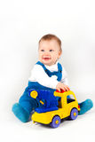 Happy little boy playing with cars and toys. stock photos