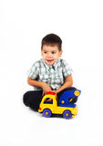 Happy little boy playing with cars and toys. Happy little baby boy playing with cars and toys Stock Photography