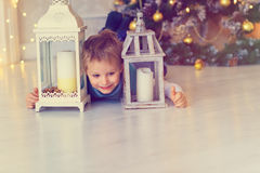 Happy little boy playing in decorated Christmas living room Stock Photography