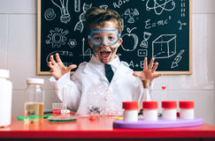 Happy little boy playing excited with experiment results Royalty Free Stock Photo