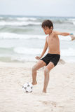 Happy little boy  playing football on beach summer. Happy family father two kids playing football on beach summer fun soccer Royalty Free Stock Photography