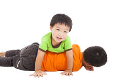 Happy little boy playing with his bother Royalty Free Stock Image