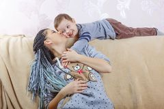 Family, Mother`s Day, son, child, smile, joyful, childhood,. Happy little boy playing with his mom, close up, copy space royalty free stock photography