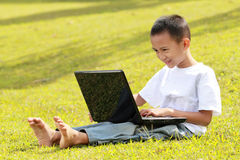 Happy little boy playing laptop Royalty Free Stock Photo
