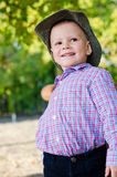 Happy little boy playing outdoors Stock Images