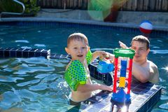 Happy little boy playing in the pool Stock Photo