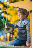 Happy little boy playing in sandbox at playground Royalty Free Stock Images