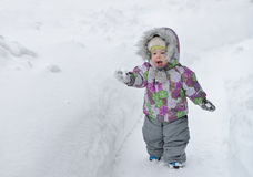 Happy little boy is playing with snow on winer background Royalty Free Stock Photography