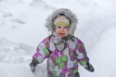 Happy little boy is playing with snow on winer background Royalty Free Stock Photos