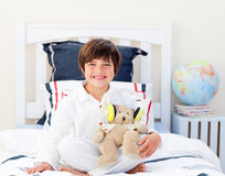 Happy little boy playing with a teddy bear Stock Images
