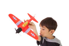 Happy little boy playing with toy airplane Royalty Free Stock Images