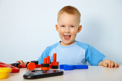 Happy little boy playing with toys Stock Photography