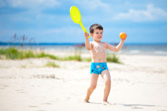 Happy little boy playing on tropical beach Royalty Free Stock Photo
