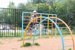 Happy little boy plays on children playground Stock Photography