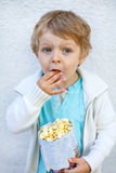 Happy little boy with popcorn bag Royalty Free Stock Images