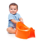 Happy little boy with potty Royalty Free Stock Photography