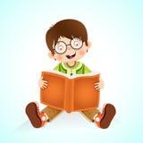 Happy little boy reading book Royalty Free Stock Photo