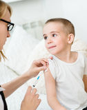 Happy little boy receiving injection or vaccine Royalty Free Stock Image