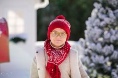 Happy little boy with red hat and green glasses, Christmas timse stock images