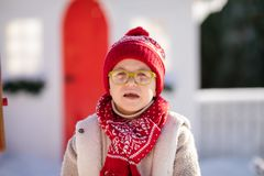 Happy little boy with red hat and green glasses, Christmas timse royalty free stock photo