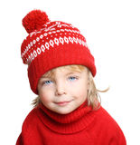 Happy little boy in red hat and sweater Royalty Free Stock Photo