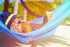 Happy little boy relaxed in hammock on the beach Royalty Free Stock Photography